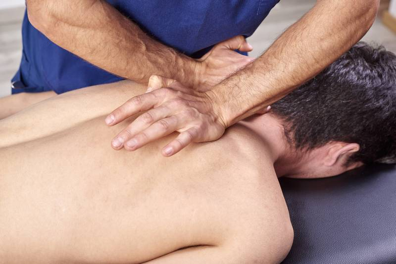 physiotherapist giving a back crack in macleod